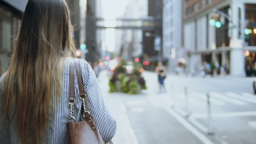 Back view of young brunette woman walking through the street of New York, America. Hair waving on wind. Slow motion. | Shutterstock HD Video #33152677