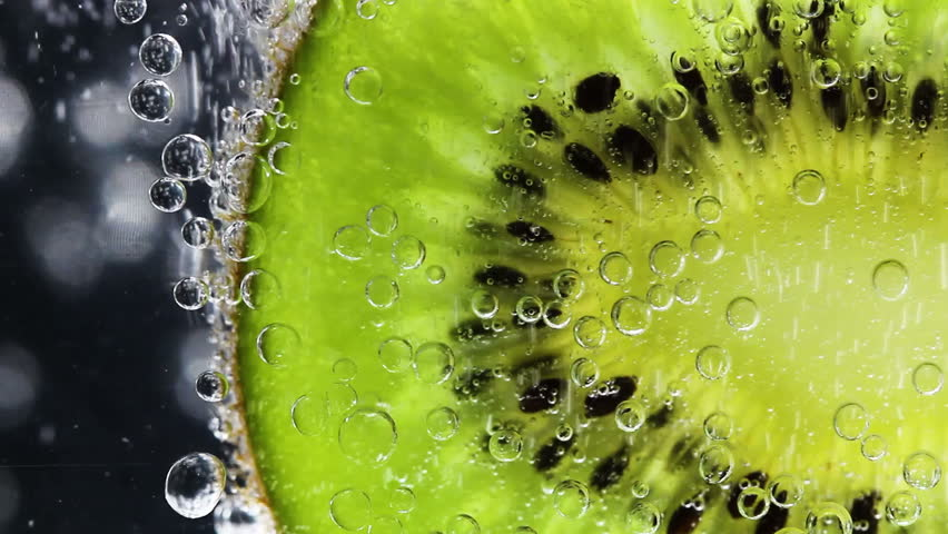 Slices of Kiwi Fruit with Water Bubbles Close Up Macro
