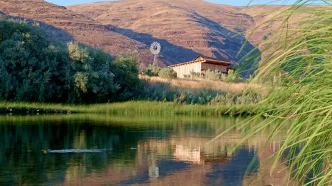 Old antique windmill and shed John Day River Cottonwood Canyon Oregon