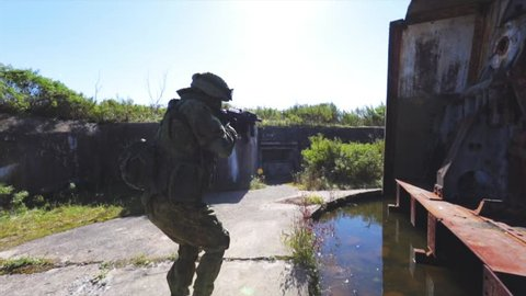 Soldier on search and destroy operation. Old AAA post.