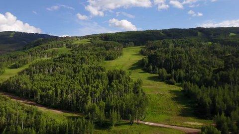 Colorado ski resort sunny summer day aerial landscape