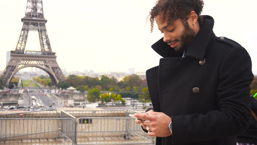 Young man dressed in black coat, has earing, black curly hair and beard. Concept of Internet innovations | Shutterstock HD Video #33229177