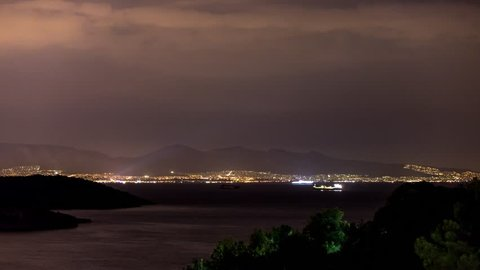 4K Timelapse at Salamina Island by night with airplane