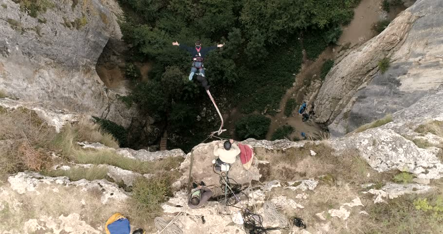 Bungee jumps, extreme and fun sport. Bungee in a cave 4k superwide
