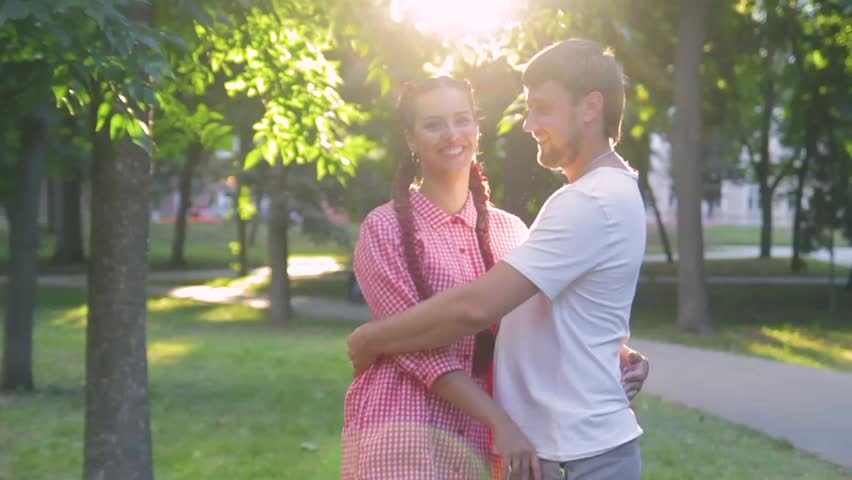 Young loving couple in the park outdoors against the trees | Shutterstock HD Video #33254887