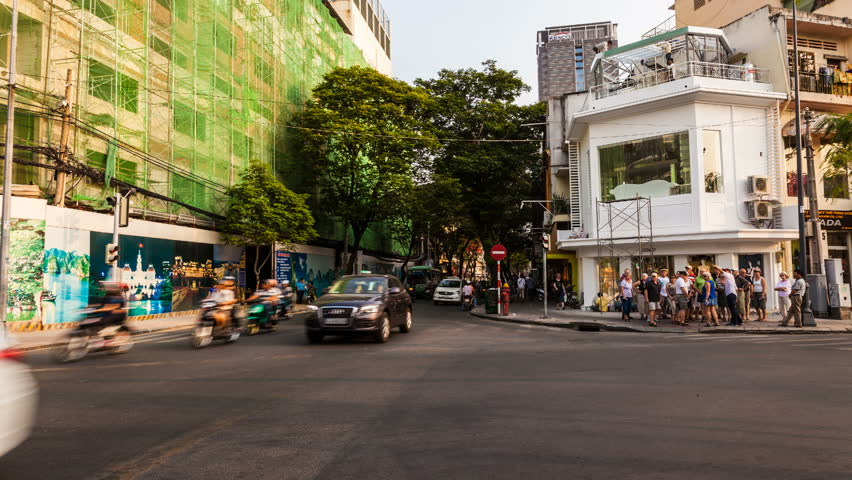HO CHI MINH CITY, VIETNAM - JANUARY 27, 2013: Timelapse view of traffic at a crossing in Saigon City Center. Unrecognizable people can be seen in the scene.