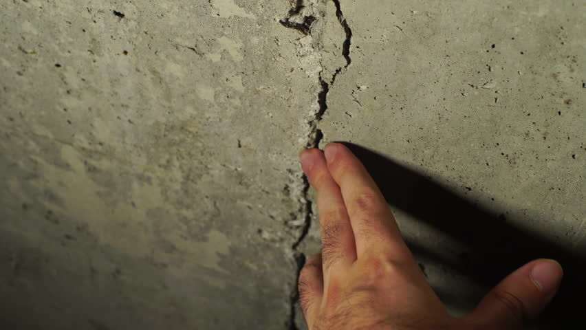 A crack in the foundation of concrete | Shutterstock HD Video #33274957
