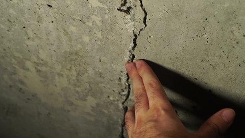 a crack in the foundation of concrete