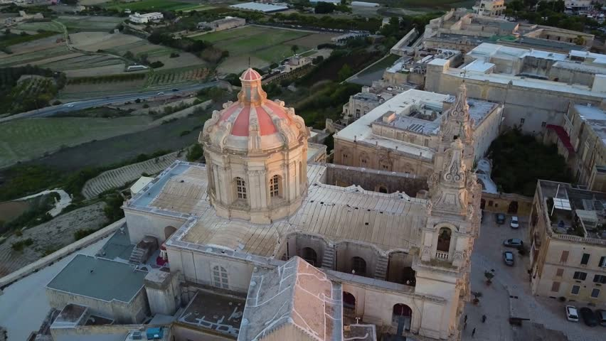 4k aerial drone sunset - St. Paul's Cathedral in the ancient medieval city of Mdina, Malta.  This fortress complex is the old capital city of Malta.