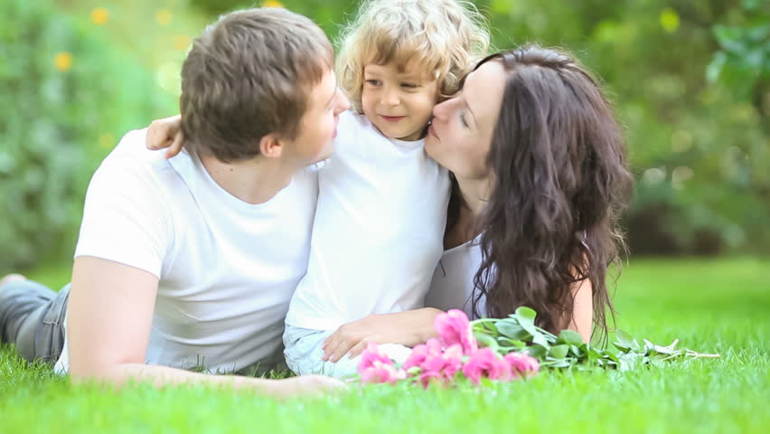 Happy family having fun outdoors in spring park  | Shutterstock Video #3329114