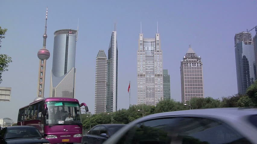 SHANGHAI, CHINA - CIRCA OCTOBER 2007: Traffic on Century Avenue with Hi Rise Buildings of Financial District Lujiazui