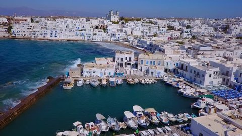 Aerial bird's eye view video taken by drone of iconic and picturesque port of Naousa village, Paros island, Cyclades, Greece