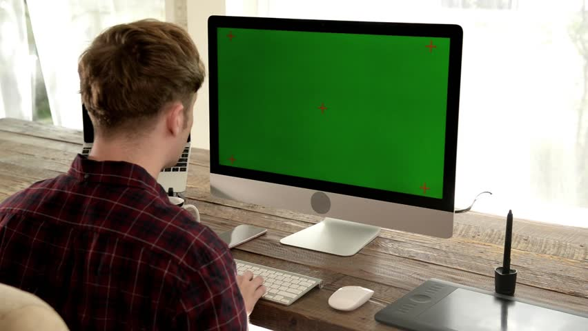 A young man working on a computer in their home. | Shutterstock HD Video #33321397