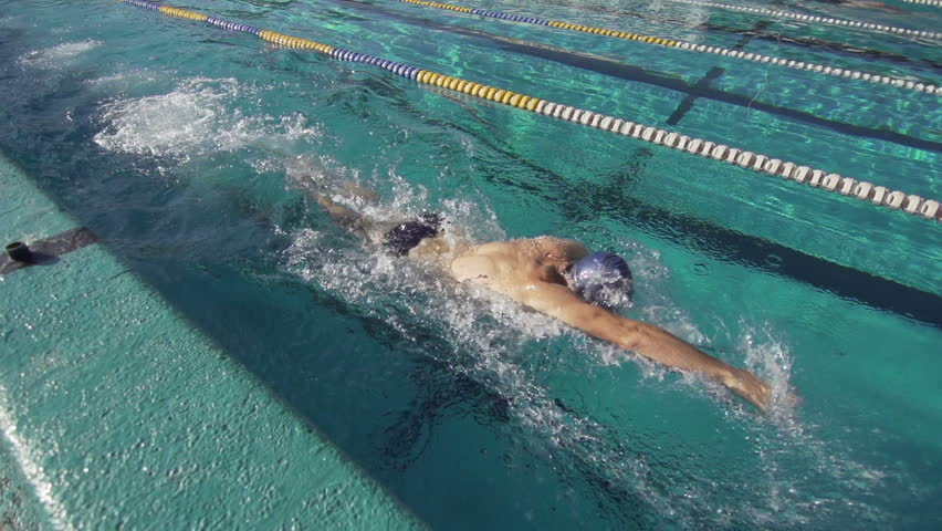 Slow Motion Of A Professional Male Swimmer Performing Front Crawl Stroke