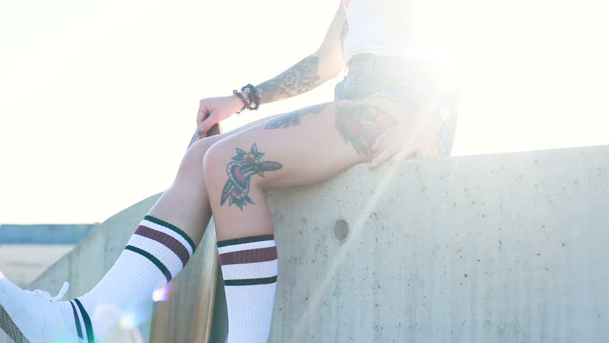 Sport, lifestyle, Extreme and people concept - Beautiful girl tattoos riding longboard on the road in the city in sunny weather. Portrait hipster girl smiling with a longboard at sunset. Slow motion | Shutterstock HD Video #33342097
