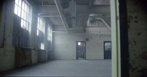 empty abandoned industrial factory warehouse loft space studio slow motion