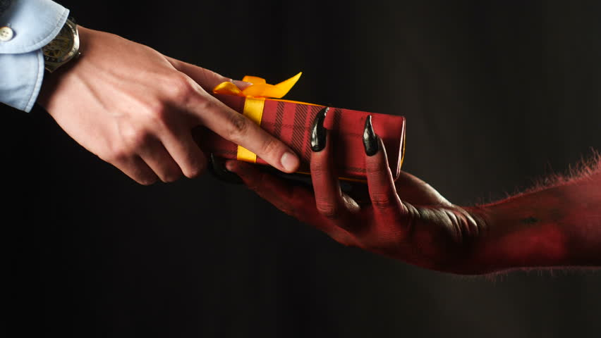 Red demon hand gives a gift to the businessman. 50 fps | Shutterstock HD Video #33388567