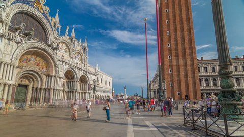 Basilica of St Mark timelapse hyperlapse and San Marco campanile. It is cathedral church of Roman Catholic Archdiocese of Venice. It lies at Piazza San Marco. Tourists walking in front of it. Venice