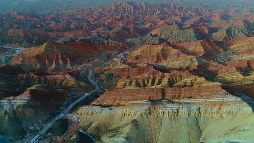 Aerial view on one of the most beautiful sections of Zhangye Danxia Rainbow Mountains showing striped pattern on sandstone hills.