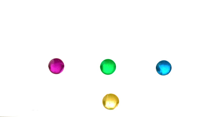 Four marbles falling and bouncing in slow motion #3352997