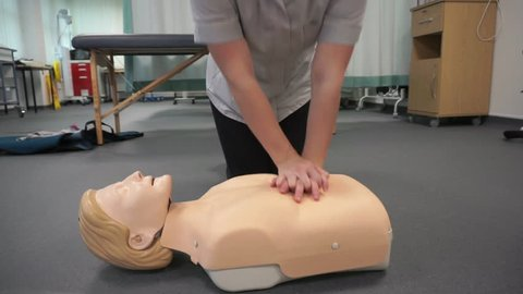 CPR chest compressions on a mannequin.