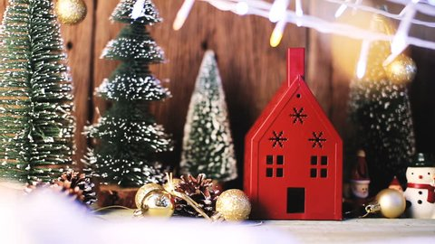 greeting season christmas and new year eve with house toy decorating items with light bokeh and pine tree on wooden table  with filter effect festive concept