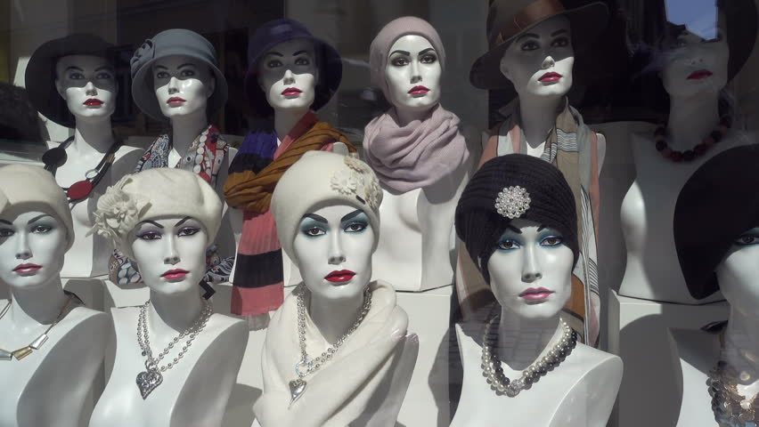 PASSAU, BAVARIA/GERMANY - SEPTEMBER 09, 2017: Mannequins with hats and necklace in fashion shop window. Bavaria is famous for traditional costume but also more modern styles.