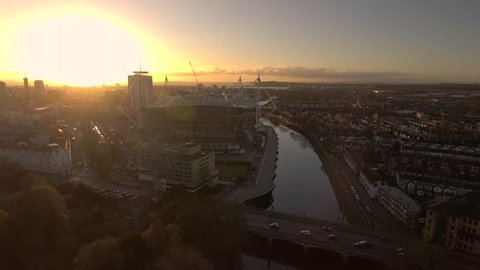 Aerial view of Cardiff city centre at sunrise.