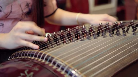 playing Chinese zither