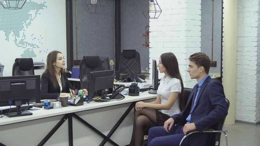 Couple of managers - young woman and man in formal attire report something to their boss woman during working day at the office | Shutterstock HD Video #33667777