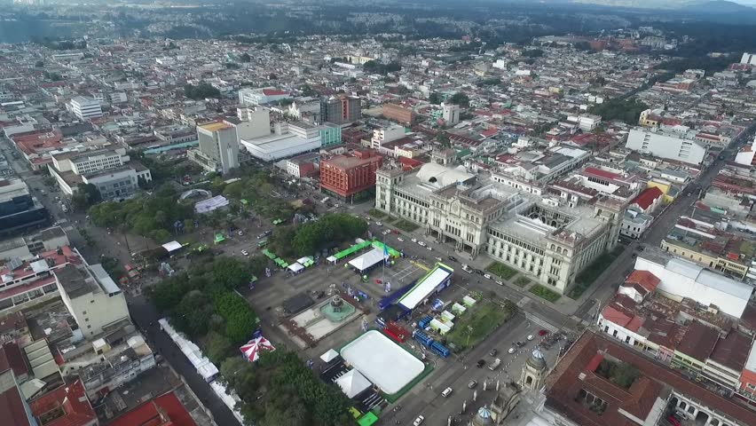 GUATEMALA - NOVEMBER 21, 2017: Cityscape of Guatemala with Santa Iglesia Catedral and National Palace of Culture. Guatemala Downtown.
