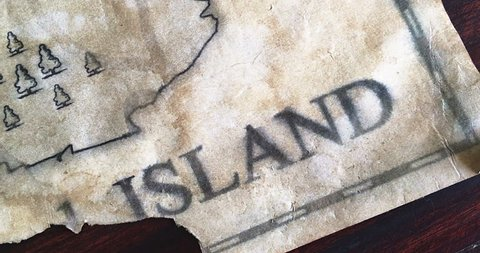 Pan camera moving over Fake pirate map with Treasure island