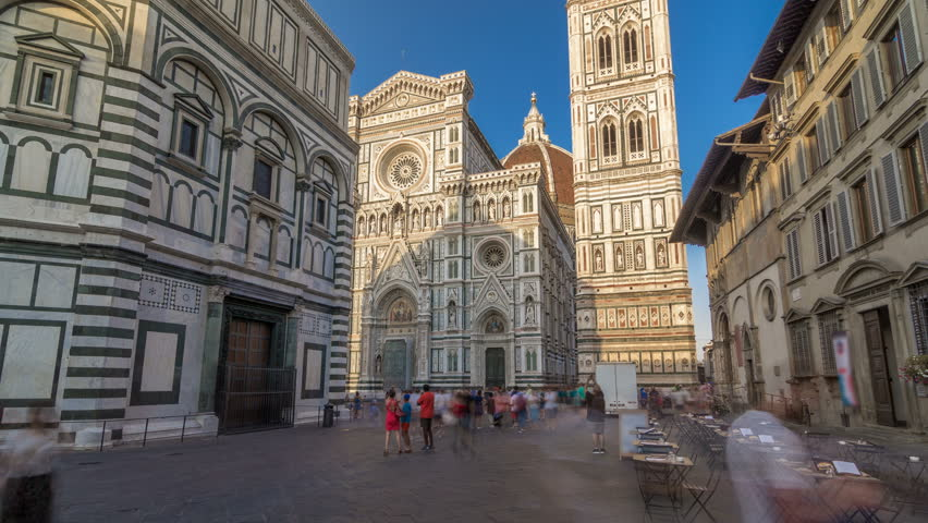 The front of The Basilica di Santa Maria del Fiore timelapse hyperlapse which is the cathedral church (Duomo) of Florence in Italy. shadows moves on facade at sunset