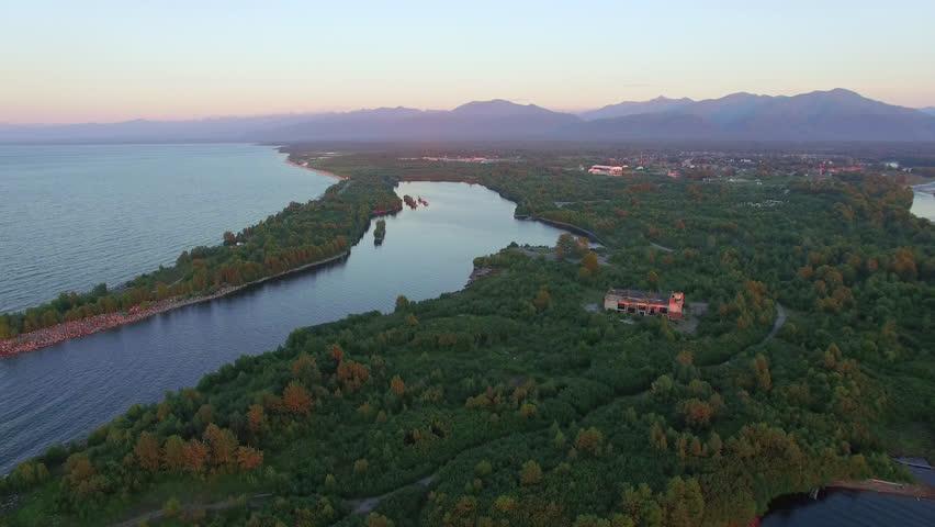 4K. Aerial photography. Settlement on the shore of Lake Baikal. Vydrino