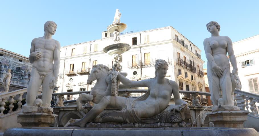 Palermo, Sicily, Italy. Dec 08 2017: Pretoria Fountain of Palermo, fountain of white marble with statues of naked people. Ita: Fontana Pretoria di Palermo, chiamata Fontana della Vergogna
