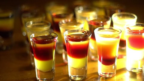 Multicolored shots on the bar. Beautiful light game.
