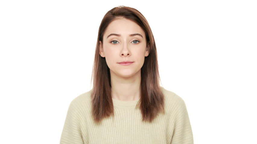 Portrait of caucasian woman in casual outfit with tricky look throwing up hands in rejection meaning don't know can't help or have no idea over white background. Concept of emotions