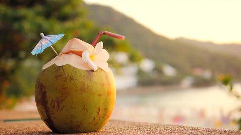 Fresh Young Coconut Water Coctail at Tropical Beach Bar. Phuket, Thailand. 4K.