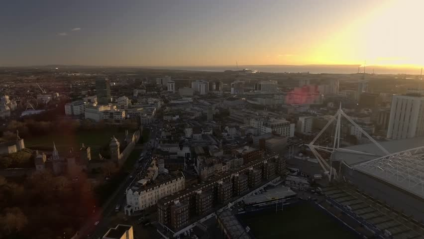 CARDIFF, WALES - 2017: Panning aerial view of Cardiff city centre and the Millennium stadium at sunrise.