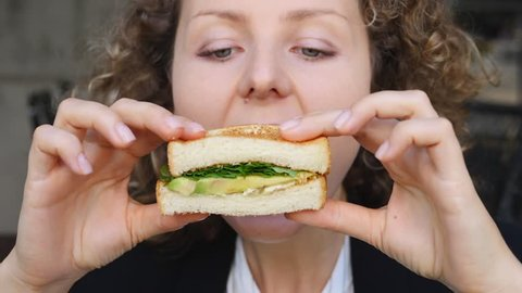 Closeup Of Hungry Girl Bites Off Veggie Avocado Sandwich. HD, 1920x1080. Slow Motion.