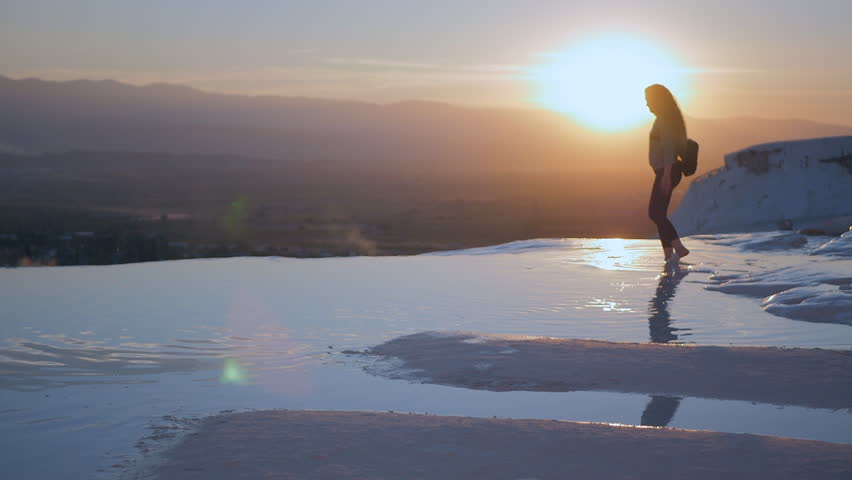 Young woman walking in Pamukkale terraces