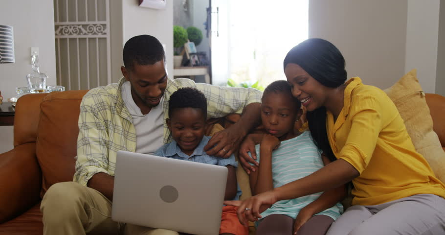 Family using laptop in living room at home 4k | Shutterstock HD Video #33755026