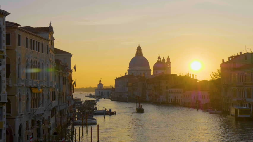 Venice Panorama view of Church Salute at sunrise, Ships, Gondola passing in Grand Canal in Venice Italy.