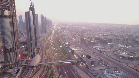 Modern buildings and highway. View on modern skyscrapers and busy evening highways day in luxury downtown of Dubai city. Top aerial view from tower rooftop. Road junction traffic. Beautiful daytime