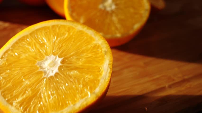 Cut orange falls in slow motion macro shot | Shutterstock HD Video #33773827