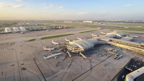 Timelapse.Aerial View.Airport Terminal at Dusk with Airplanes Taxiing,Taking off and Landing.Beijing,China.