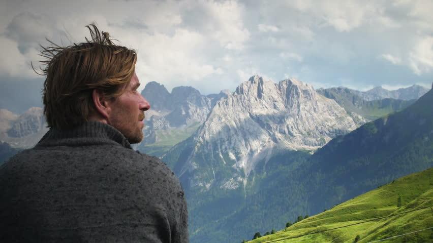 Man gazing at mountains crest peaks