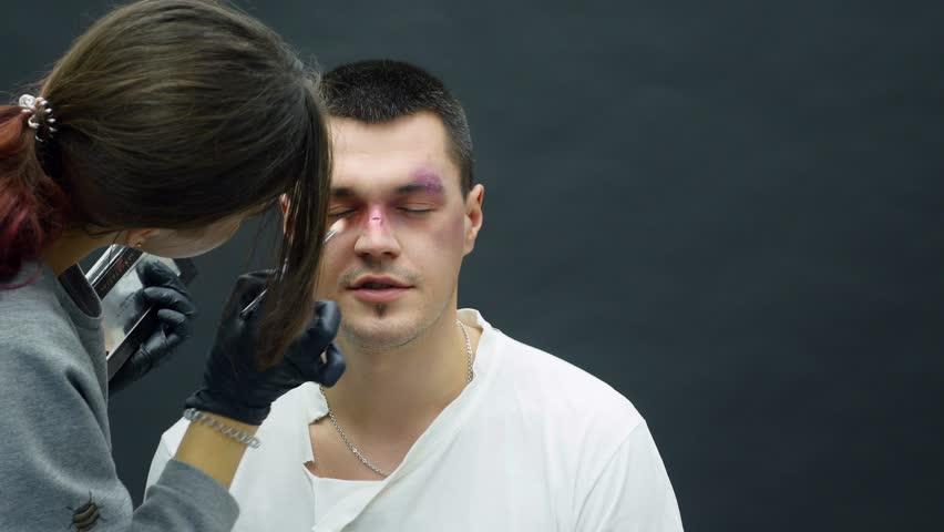 Makeup artist at work applying special effects makeup