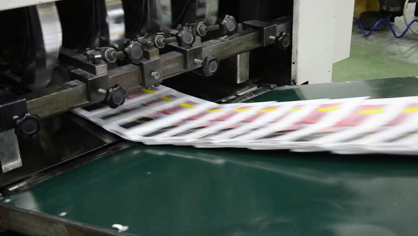 finished brochure magazine goes on the packaging line after it is printed on the web offset hit set press