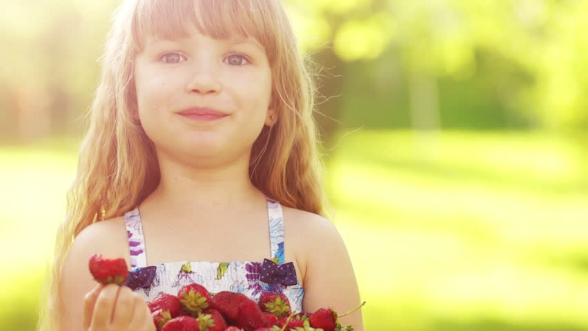 Laughing child eating strawberries 2